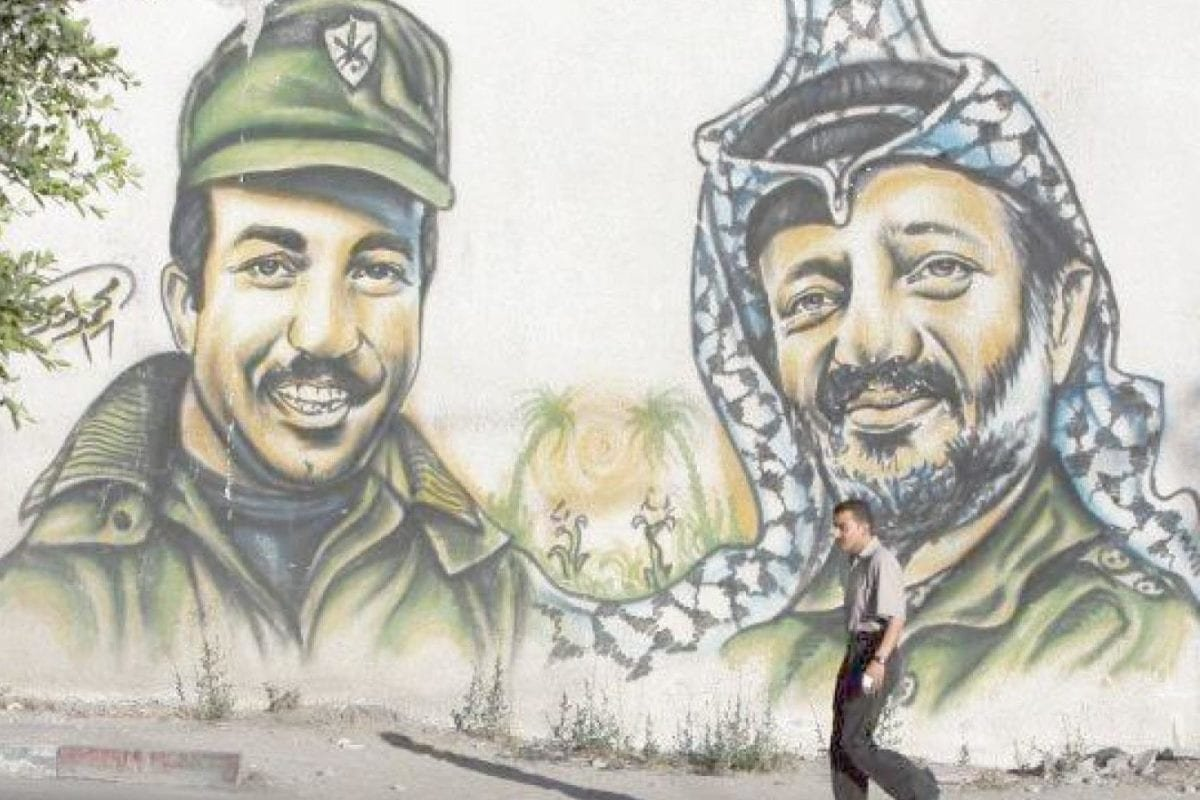 A street mural of the co-founders of the Fatah movement Khalil Al-Wizar (aka Abu Jihad) [left] and Yasser Arafat, seen in the West Bank, Palestine (undated)