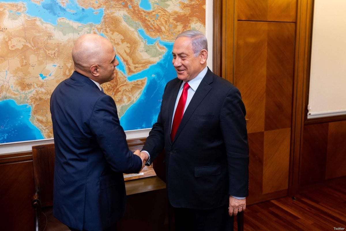 UK home secretary Sajid Javid shakes hands with Israeli PM Benjamin Netanyahu [Twitter]