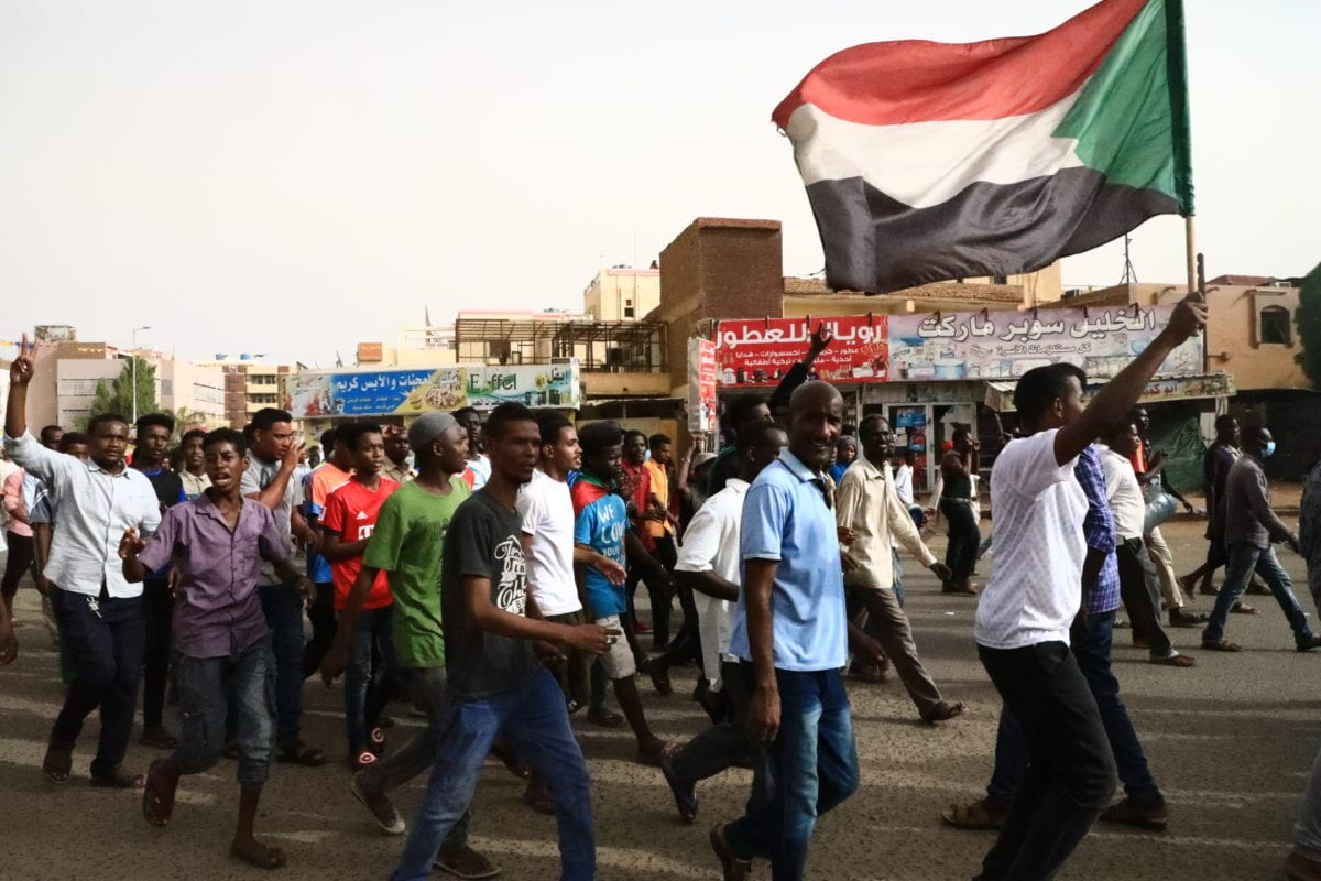 Thousands of Sudanese protesters, take part in a march towards Defence Ministry after the call from Sudanese Professionals Association (SPA) and Alliance of Freedom and Change, demanding the ruling military council to hand over power to civilian authorities, in Khartoum, Sudan on 30 June 2019. [Mahmoud Hjaj - Anadolu Agency]