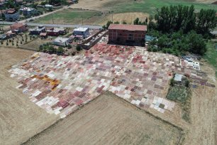 A drone photo shows thousands of colorful hand made carpets laid under the sun on a field to soften their color in Dosemealti district of Turkey's Southern touristic province Antalya, Turkey on July 2, 2019. ( Orhan Çiçek - Anadolu Agency )