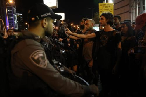 Security forces take measures during a protest at Menahem Begin Street against the killing of Solomon Tekah, a young man of Ethiopian origin, who was killed by an off-duty police officer, in Tel Aviv, Israel on 3 July 2019. [Oren Ziv - Anadolu Agency]