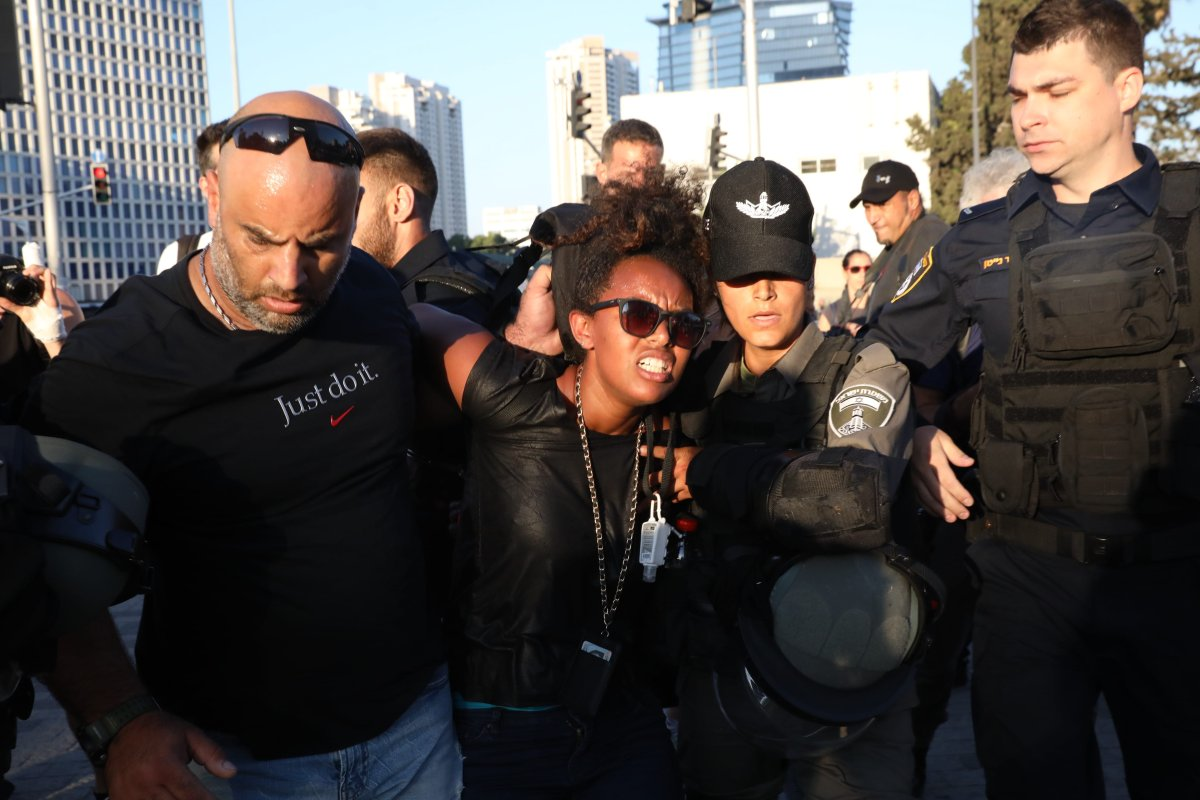 Security forces take a protester into custody during a protest against the killing of Solomon Tekah, a young man of Ethiopian origin, who was killed by an off-duty police officer, near Azrieli Tower in Tel Aviv on 3 July 2019 [Oren Ziv/Anadolu Agency]