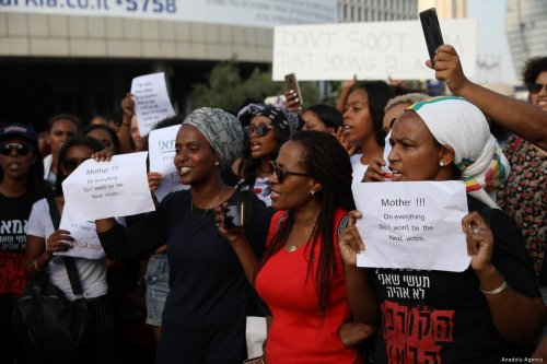 Demonstrators stage a protest against the killing of Solomon Tekah, a young man of Ethiopian origin, who was killed by an off-duty police officer, near Azrieli Tower in Tel Aviv, Israel on 8 July, 2019 [Oren Ziv/Anadolu Agency]
