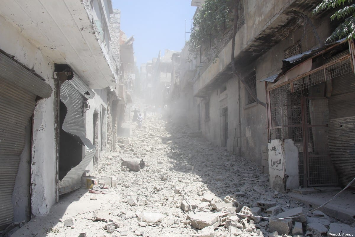 A view of collapsed buildings at the site after warplanes of Assad regime forces and Russian forces hit the de-escalation zone, Jisr al-Shughur district of Idlib, Syria on July 11, 2019. [Bera Derwish - Anadolu Agency]