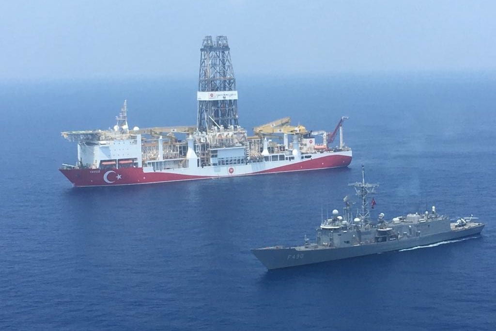 An aerial photo shows Turkish-flagged drill ship Fatih' continue offshore drilling operations in company with Turkish battleship and a helicopter in the west of the Island of Cyprus in the Mediterranean Sea on July 11, 2019 [Turkish National Defence Ministry / Handout - Anadolu Agency]