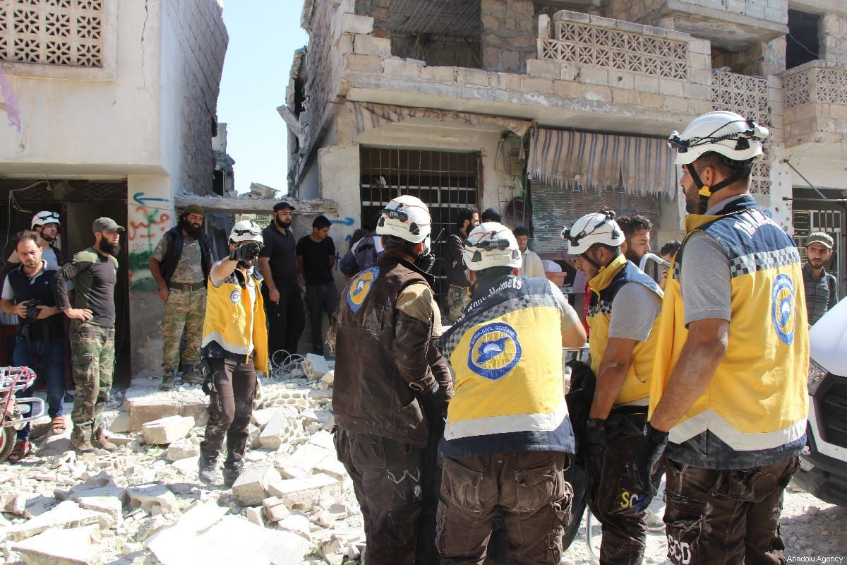 Civil defense crews remove a dead body from the scene after airstrikes by Assad Regime and Russia's warplanes hit the de-escalation zone of Kafriya village in Idlib, Syria on 13 July 2019. [Ahmet Weys - Anadolu Agency]