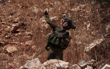 An Israeli soldier intervenes Palestinians during a protest against the construction of Jewish settlements and the separation wall in Qafr Qaddum village in Nablus, West Bank on 26 July 2019 [Nedal Eshtayah/Anadolu Agency]