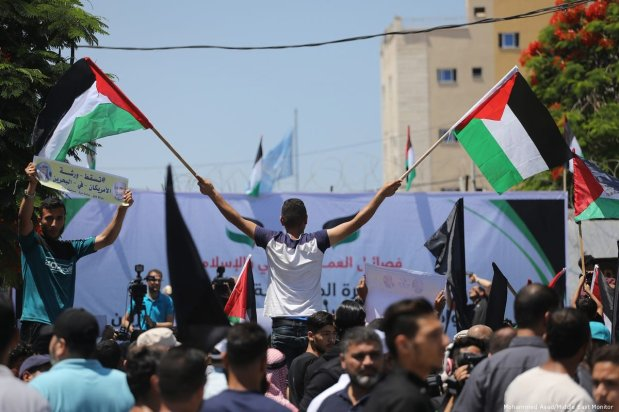 Palestinian protesters demonstrate against the US-led Bahrain workshop