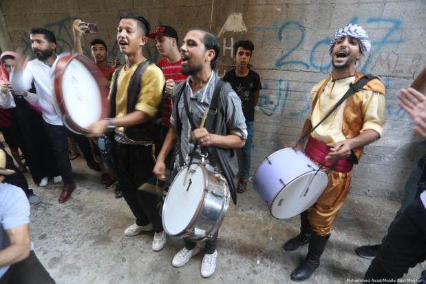 Palestinians celebrate after they received their school exams results on 18 July 2019 [Mohammed Asad/Middle East Monitor]