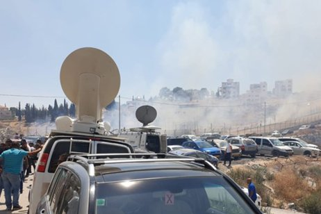 Israeli occupation forces disperse Palestinians who have gathered at the site of properties it demolished this week in the occupied East Jerusalem district of Sur Baher on 26 July 2019