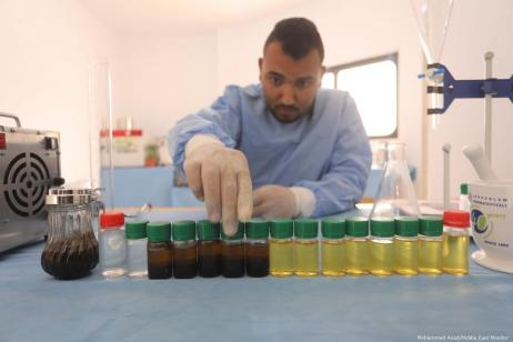 Despite Israel banning the apparatus needed to distil the oils from entering Gaza, Fida Abu Elian has found a way to extract medical oils from natural herbs using a pressure cooker and boiling water [Mohammed Asad/Middle East Monitor]