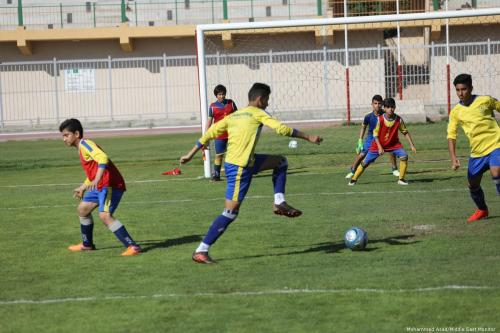Players from the Khadamat Rafah, the Gaza football team [Mohammed Asad/Middle East Monitor]
