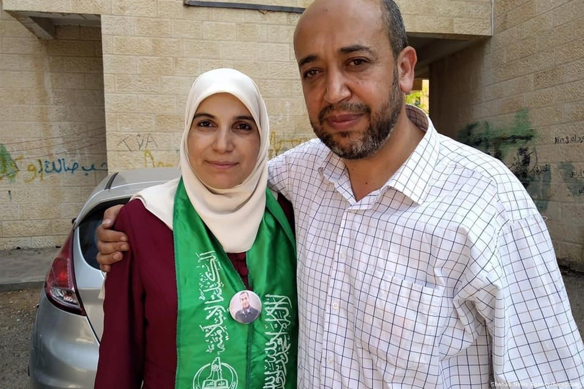 Palestinian writer and journalist Lama Khater talks to press after being released from prison on 26 July 2019 [Shehab News Agency/Facebook]