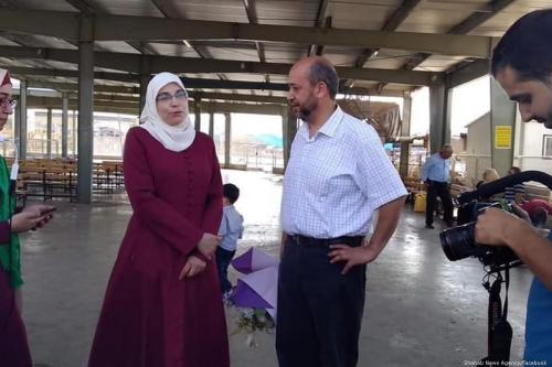 Palestinian writer and journalist Lama Khater talks to press after she was released from prison on 26 July 2019 [Shehab News Agency/Facebook]