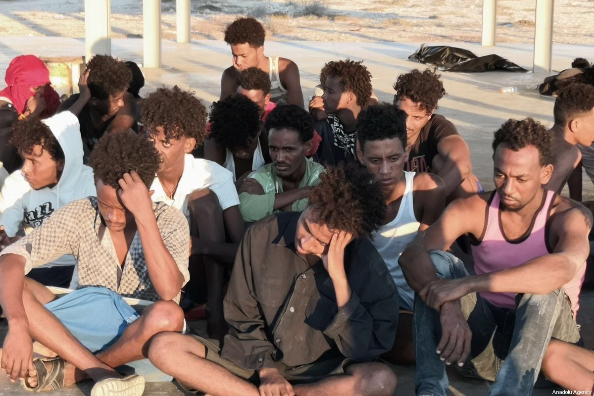 A group of migrants, rescued by Libyan Coastal Guard, wait after a boat sank off the city of Al-Khoms, Libya 5 miles from the coast on 25 July 2019 [Hazem Turkia/Anadolu Agency]