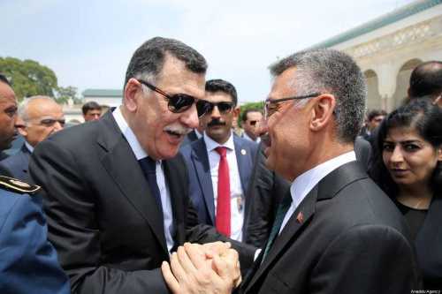 Turkey's Vice President Fuat Oktay (C-R) talks with head of Libya's Government of National Accord (GNA), Fayez Al-Sarraj (C-L) in Tunis, Tunisia on 27 July 2019 [Arda Küçükkaya/Anadolu Agency]