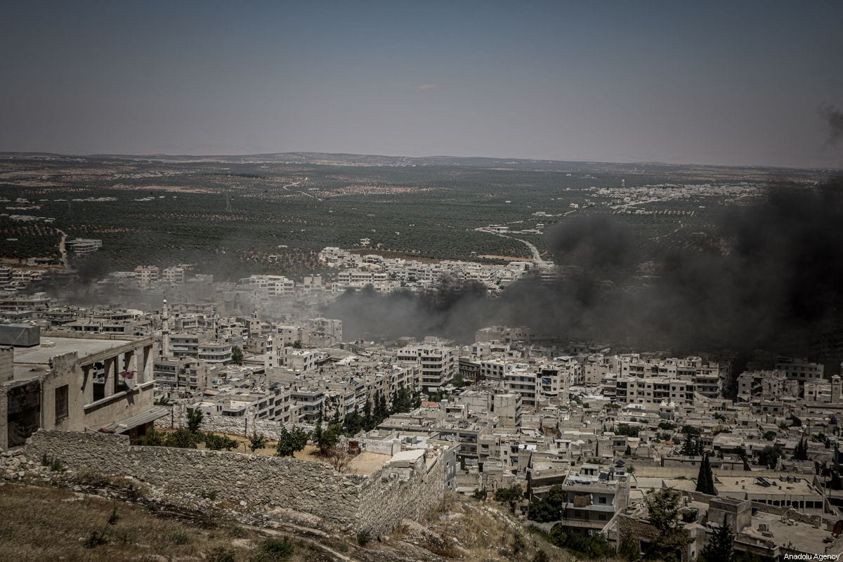 Smoke rises after Assad Regime warplanes carried out airstrikes on the town of Arihah in Idlib province, Syria on July 28, 2019 [Muhammed Said / Anadolu Agency]