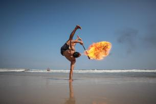 Palestinian fire spitting artists gather to perform fire show at the beach of Gaza shore in Gaza City, Gaza on 8 August, 2019 [Mustafa Hassona/Anadolu Agency]