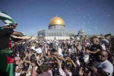 Muslims perform the Eid Al Adha (Feast of Sacrifice) prayer at Al-Aqsa Mosque in Jerusalem on 11 August 2019 [Faiz Abu Rmeleh/Anadolu Agency]