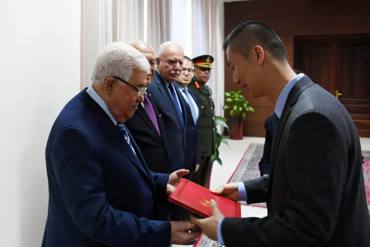 Palestinian President Mahmoud Abbas accepts the credentials of the ambassador of the Republic of China to the State of Palestine, in the West Bank city of Ramallah, on April 24, 2018 [Thaer Ganaim / ApaImages]