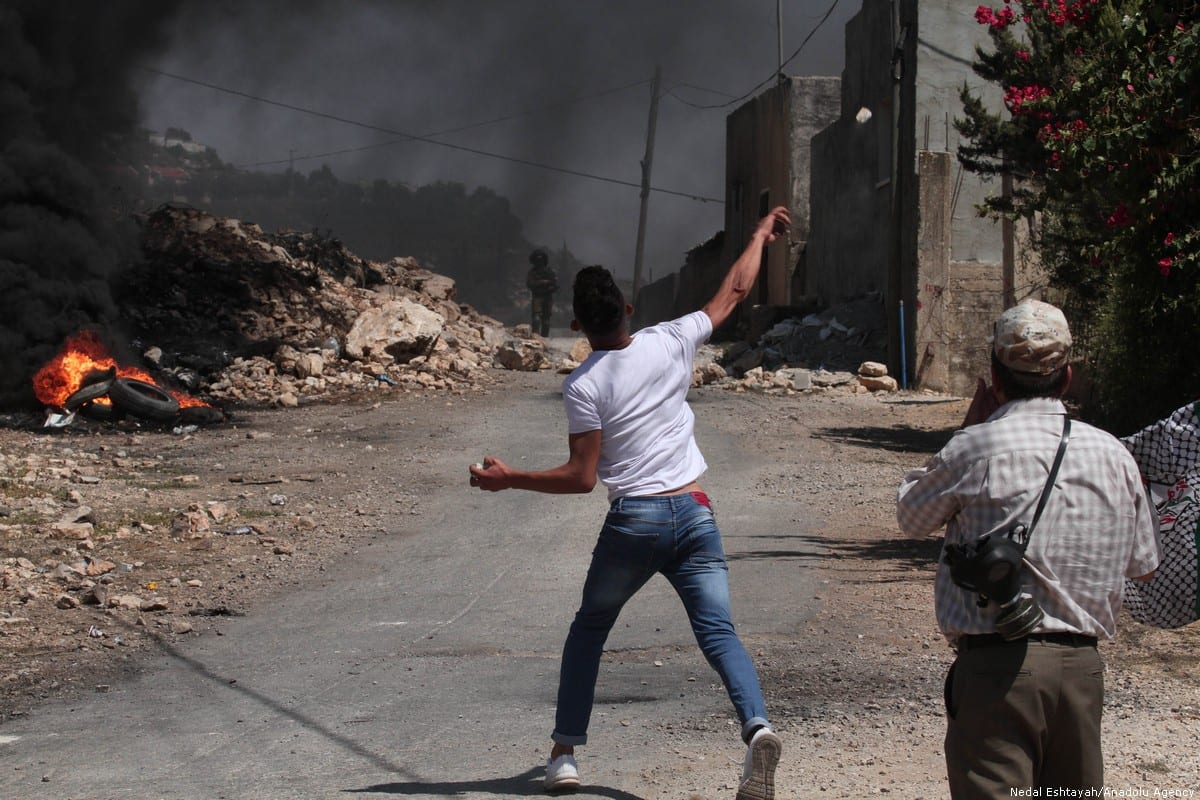 Palestinian respond to Israeli forces' intervention during a demonstration against Jewish settlement construction and discrimination wall at Qafr Qaddum village in Nablus, West Bank on 16 August 2019 [Nedal Eshtayah/Anadolu Agency]