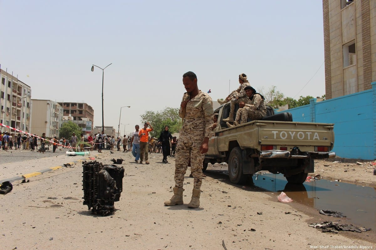 Security forces take security measures at the site of a car bomb attack took place at police station, which was happened as conscripts were gathering for morning assembly, in Aden, Yemen on August 01, 2019. [Wael Shaif Thabet - Anadolu Agency]