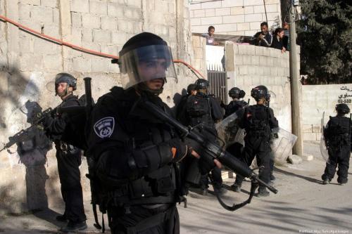 Israeli soldiers stand guard in Issawiya, East Jerusalem on 19 December 2012 [Mahfouz Abu Turk/Apaimages]