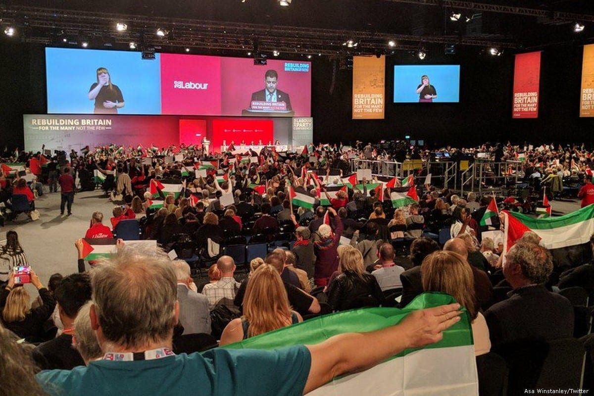 Palestinian flags are seen at the the Labour Party conference during the motion to end British arms sales to Israel on 25 September 2019 [Asa Winstanley/Twitter]