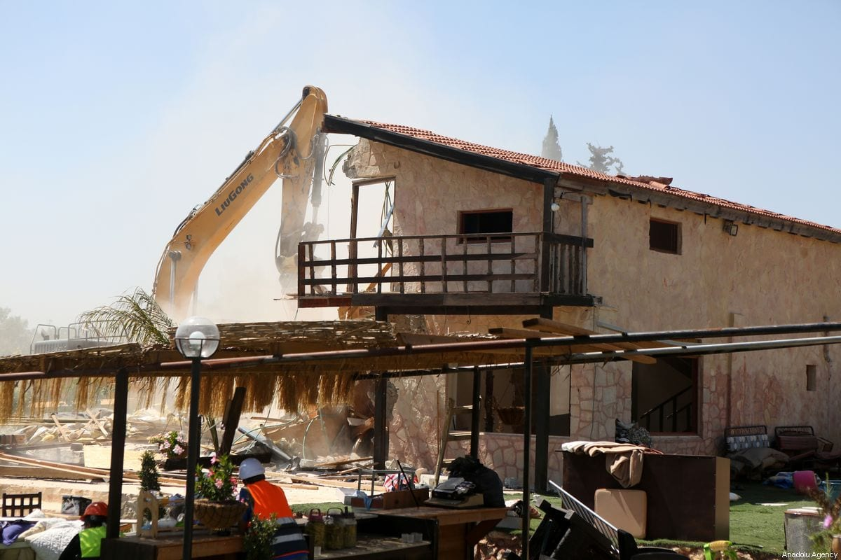 Israeli forces demolish a restaurant belongs to Palestinians in the West Bank on 26 August 2019 [Wisam Hashlamoun/Anadolu Agency]