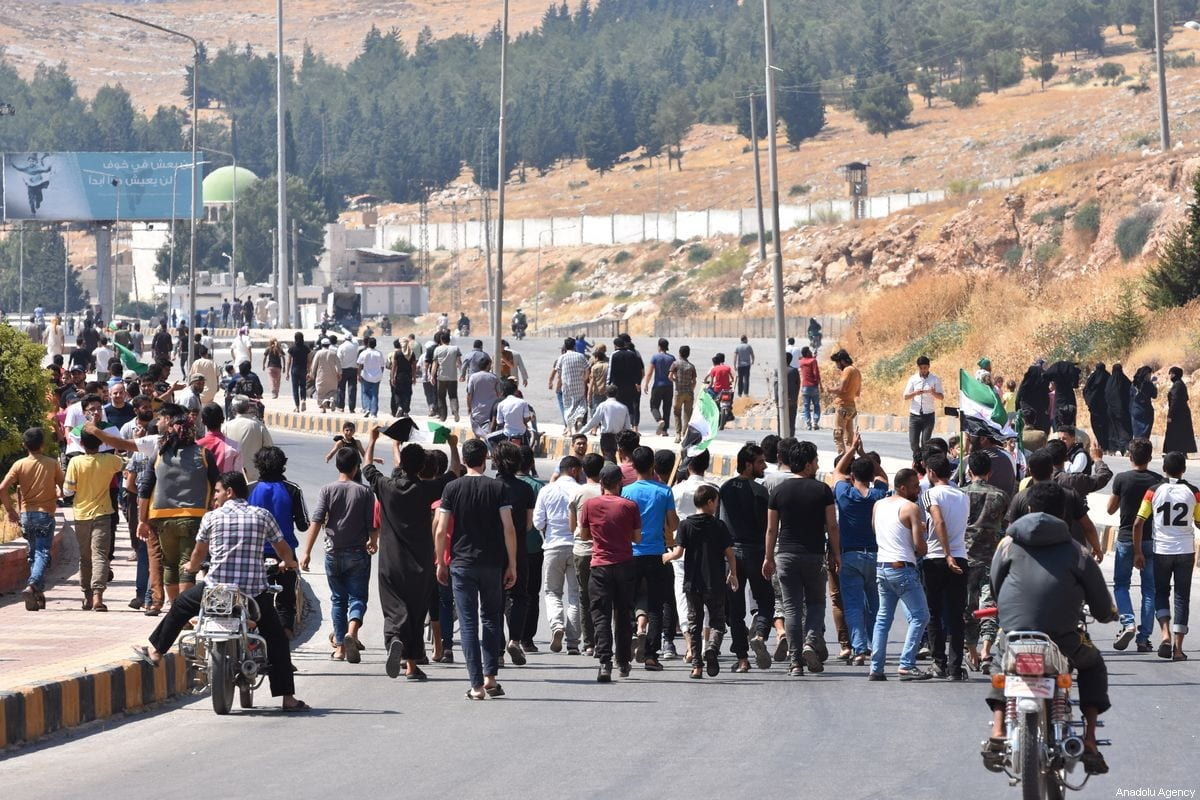 Demonstrators gather to protest against attacks of Assad Regime and Russia after performing the Friday prayer at the Bab al Hawa Border Gate in Idlib, Syria on 30 August 2019. [Esref Musa - Anadolu Agency]
