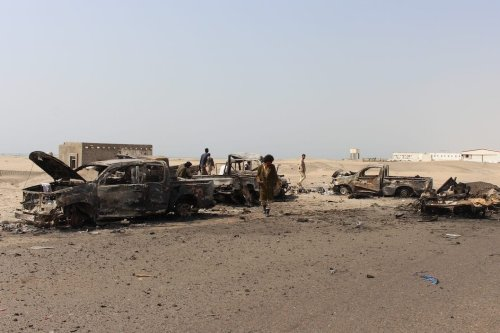 Yemeni fighters inspect burnt out vehicles as they take under control the site, reportedly belonging to pro-government troops following air strikes by Emirati forces on Yemen's interim capital Aden, Yemen on 30 August 2019 [Wail Qubati / Anadolu Agency]