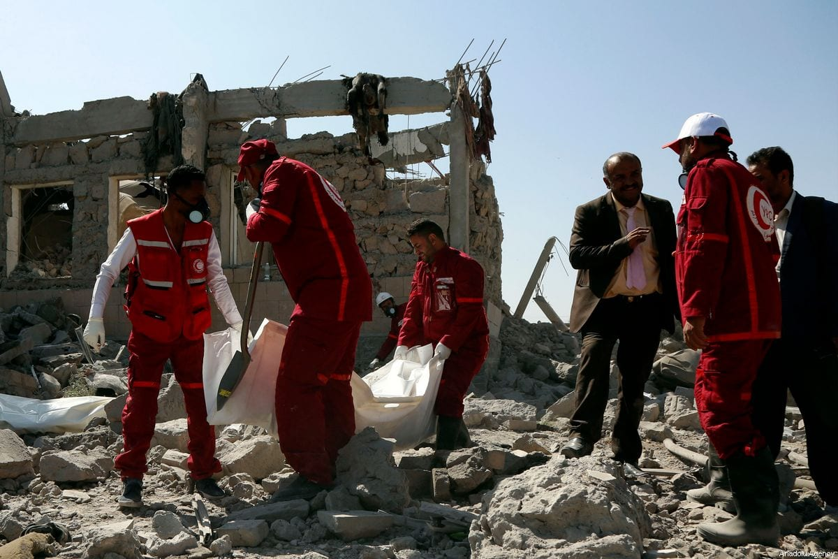Yemen Red Crescent members conduct an operation after coalition forces led by Saudi Arabia carried out air strikes in Dhamar, Yemen on 1 September 2019 [Mohammed Hamoud/Anadolu Agency]