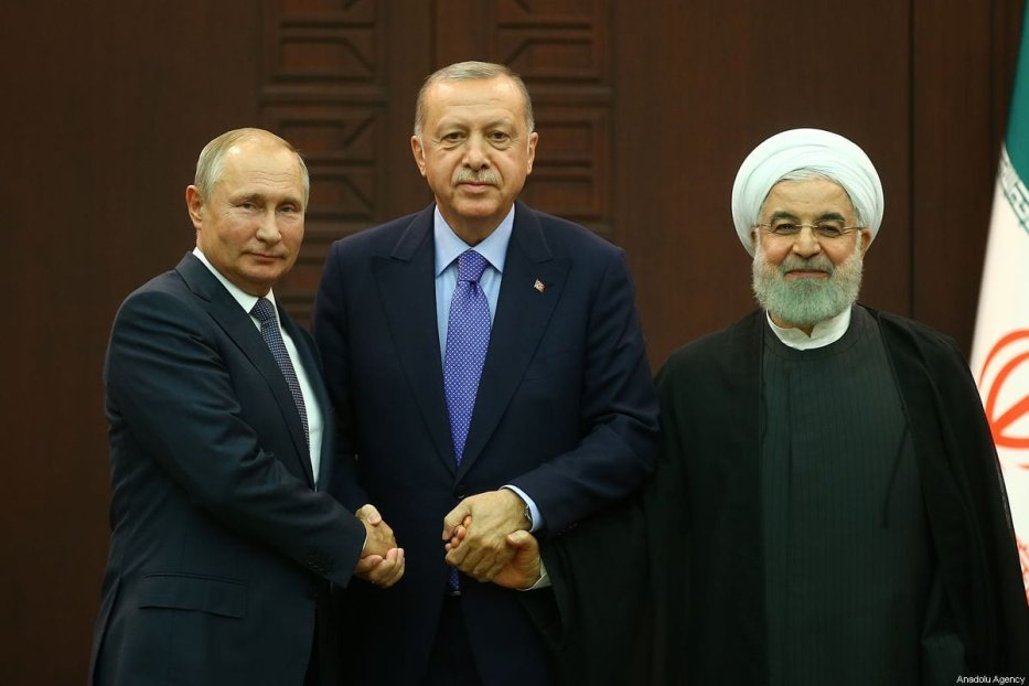 President of Turkey Recep Tayyip Erdogan (C), President of Russia Vladimir Putin (L) and President of Iran Hassan Rouhani (R) pose for a photo after the joint press conference held within the Turkey-Russia-Iran trilateral summit at Cankaya Mansion in Ankara, Turkey on 16 September 2019. [Volkan Furuncu - Anadolu Agency]