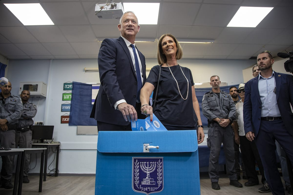 Leader of the Blue and White political alliance, former chief of staff of the Israeli army, Benny Gantz (L) and Revital Gantz (R) cast their votes during the Israeli legislative elections, at a polling station in Rosh Haayin district of Tel Aviv, Israel on 17 September 2019. [Faiz Abu Rmeleh - Anadolu Agency]