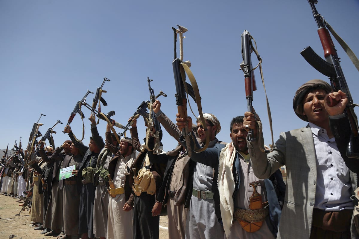 Supporters of the Houthis participate in a march to mark the 5th anniversary of Houthis' control of the Yemeni capital Sanaa, on 21 September 2019 [Mohammed Hamoud/Anadolu Agency]