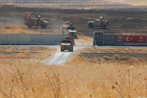 Turkish and US troops are seen along the Syrian-Turkish border on 24 September 2019 [Mustafa Güçlü/Anadolu Agency]