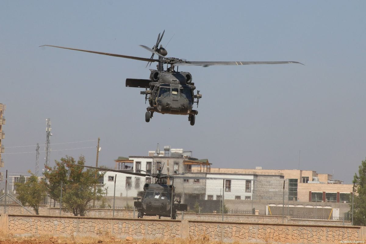A photo taken from Turkey's Sanliurfa province shows helicopters conducting a joint Turkish and US armed forces' flight for a planned safe zone east of the Euphrates River in northern Syria on September 28, 2019 in Sanliurfa, Turkey [Mustafa Güçlü / Anadolu Agency]