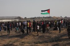Palestinians demonstrate against Israel's decades-long occupation of Palestinian territories near a fence between the Gaza Strip and Israel on Friday 6 September 2019 in Gaza. [Mohammed Asad/Middle East Monitor]