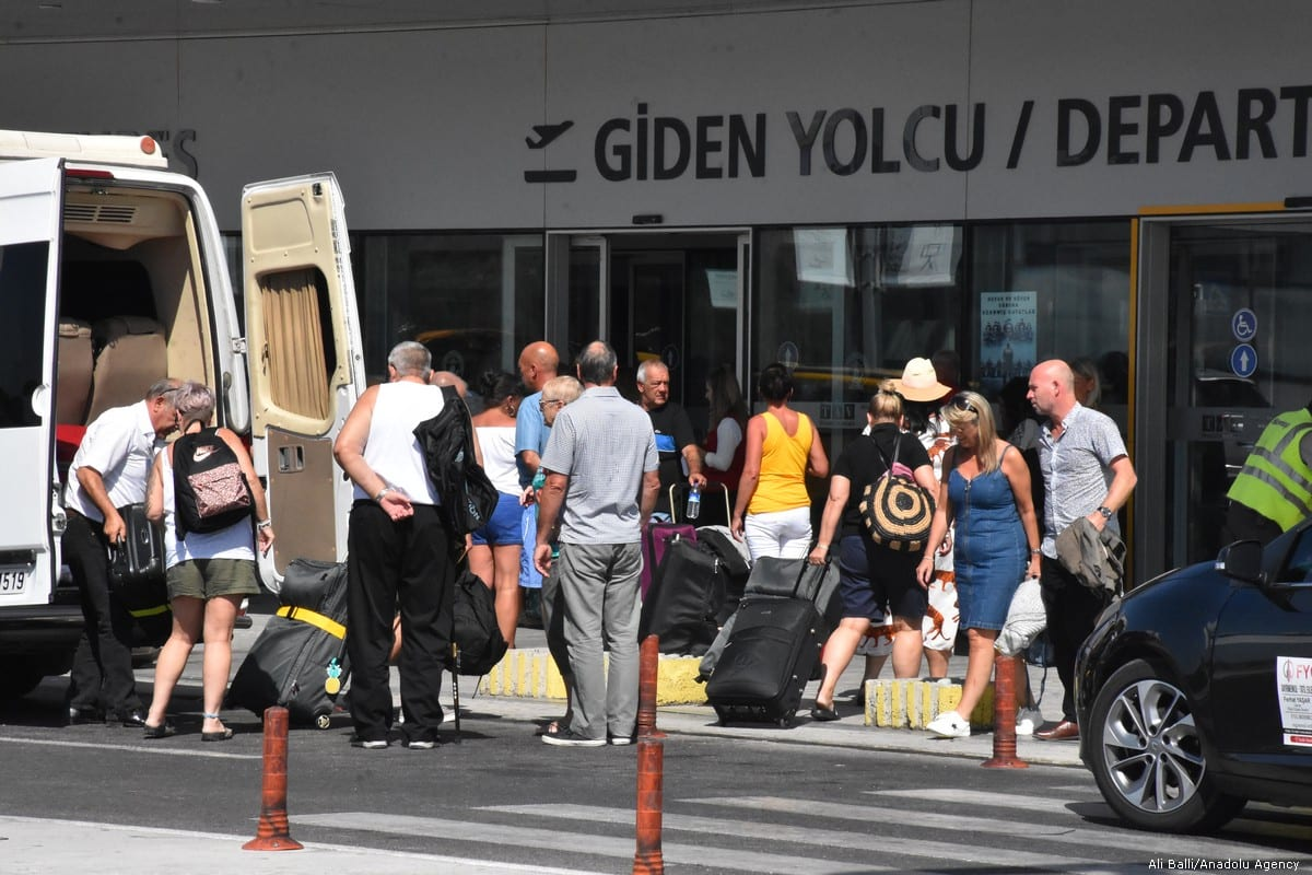 Passengers Anxiously Wait for Flights in Spain Following Thomas Cook Collapse