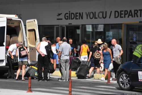 British tourists, flying with Thomas Cook, queue at Mugla Milas Airport, in Mugla, Turkey on 24 September 2019 [Ali Ballı/Anadolu Agency]