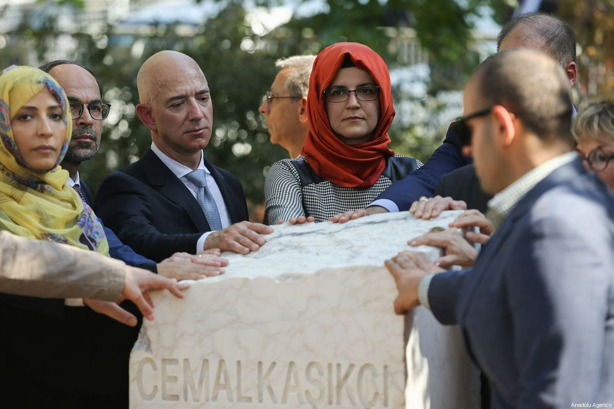 The fiancee of murdered Saudi Arabian journalist Jamal Khashoggi, Hatice Cengiz (4th L), Amazon CEO Jeff Bezos (3rd L), Nobel Peace Prize Winner Tawakkol Karman (2nd L) and Publisher and chief executive officer of The Washington Post Fred Ryan (not seen) attend the opening ceremony of Jamal Khashoggi's monument with his name, birth and death date in front of the Saudi consulate on the first anniversary of his murder, in Istanbul, Turkey on 2 October 2019. [Arif Hüdaverdi Yaman - Anadolu Agency]