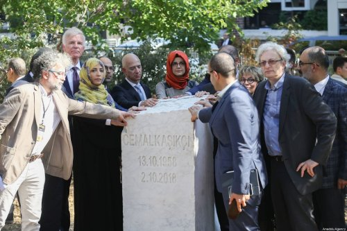 The fiancee of murdered Saudi Arabian journalist Jamal Khashoggi, Hatice Cengiz (5th L), Amazon CEO Jeff Bezos (4th L), Nobel Peace Prize Winner Tawakkol Karman (2nd L) and Publisher and chief executive officer of The Washington Post Fred Ryan (rear L), Head of the Turkish-Arab Media Association (TAM) Turan Kislakci (R) and AK Party Chairman Advisor Yasin Aktay (2nd R) attend the opening ceremony of Jamal Khashoggi's monument with his name, birth and death date in front of the Saudi consulate on the first anniversary of his murder, in Istanbul, Turkey on 2 October 2019. [Arif Hüdaverdi Yaman - Anadolu Agency]