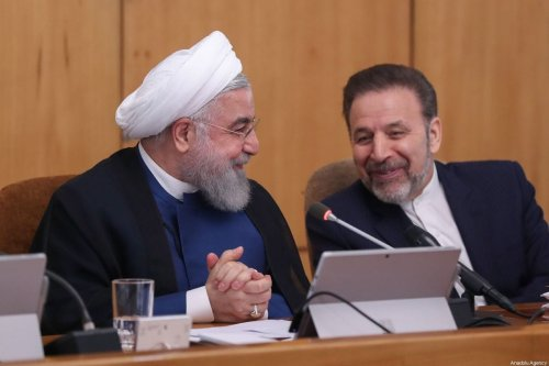 Iranian President Hassan Rouhani (L) talks with Iranian President's Office Mahmoud Vaezi (R) during the Council of Ministers meeting in Tehran, Iran on 2 October 2019. [IRANIAN PRESIDENCY / HANDOUT - Anadolu Agency]