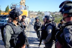 Israeli forces take security measures at the site during a demolishment of a house which was under construction, belongs to a Palestinian Ali Mohammad al-Allami with the claim of being unlicensed, at Beit Ummer district in Hebron, West Bank on 3 October 2019. [Mamoun Wazwaz - Anadolu Agency]