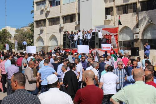 People gather to stage a rally in support of teachers who launched nationwide strike demanding salary hike, in Amman, Jordan on October 03, 2019 [Laith Joneidi / Anadolu Agency]