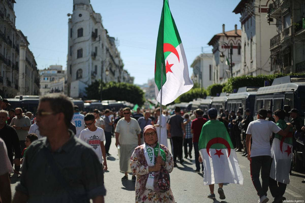 Algerians stage a demonstration demanding regime officials - who continue to work after former President Abdelaziz Bouteflika resigned - to step down, in Algiers, Algeria on October 04, 2019 [Mustafa Hassona / Anadolu Agency]