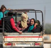 Uprooted by war, Kurdish families stuck at Syria-Iraq border crossing
