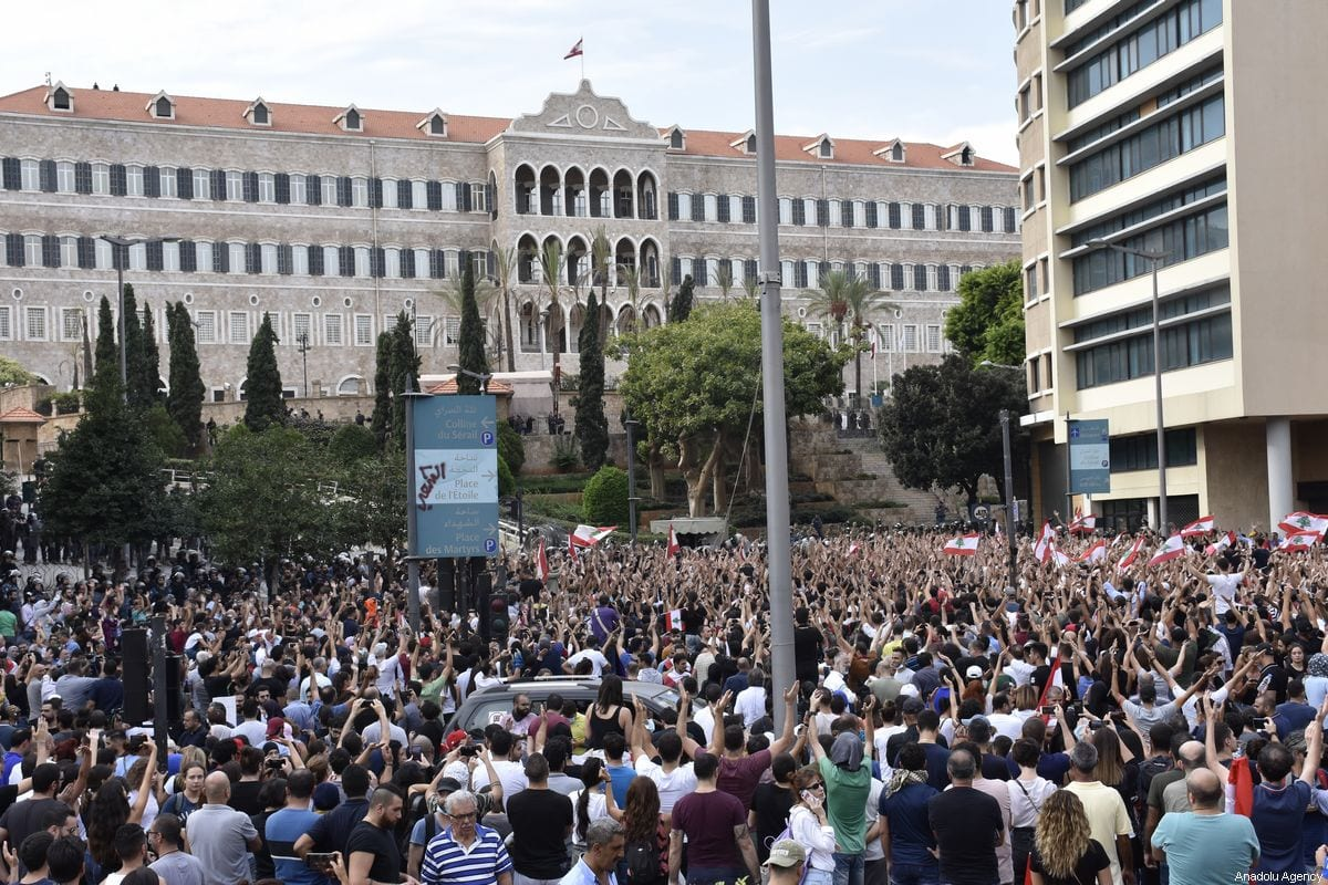 Lebanese demonstrators gather at Martyrs' Square for an anti-government protest against dire economic conditions and new tax regulations on communication on October 18, 2019 in Beirut, Lebanon [Mahmut Geldi / Anadolu Agency]