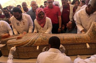 A wooden coffin, whose brightly-coloured decorations are still visible, is introduced to press members after it was uncovered at the Theban necropolis of Asasif in Luxor, Egypt on October 19, 2019 [EGYPT'S MINISTRY OF ANTIQUITIES / HANDOUT - Anadolu Agency]