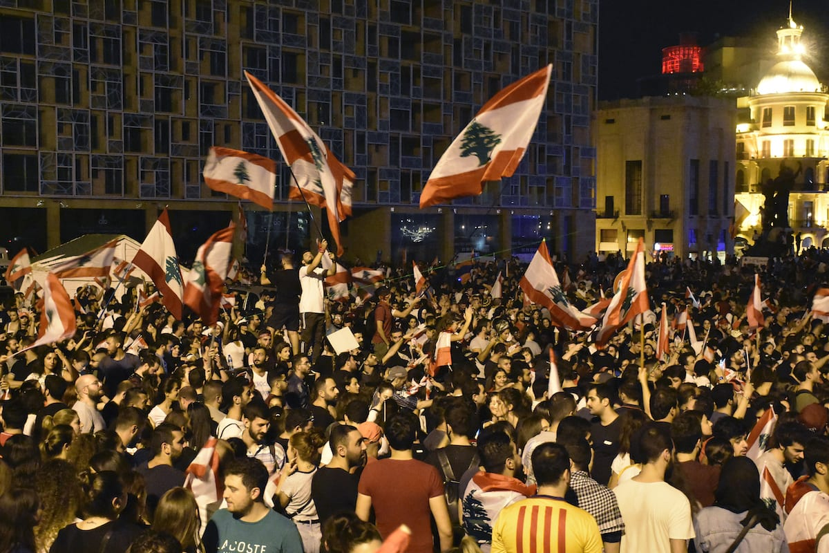 Lebanese demonstrators demanding resignation of the government gather at Martyrs' Square during an anti-government protest against dire economic conditions and new tax regulations on messaging services like Whatsapp, in front of the Mohammad Al-Amin Mosque in Beirut, Lebanon on 20 October 2019 [Mahmut Geldi/Anadolu Agency]